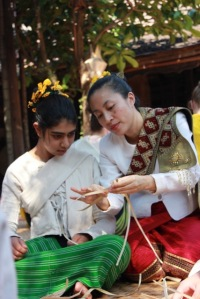 wearing traditional costumes we teach participants young and old crafts of the Lanna kingdom